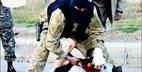تصاوير ذبح وحشت ناك يك افسر عراقي توسط جلادان داعش