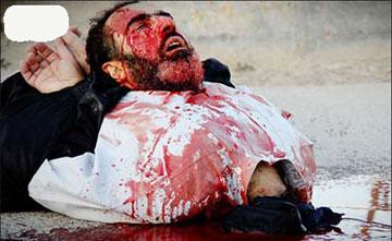 داعش,جنایت داعش,بریدن گلو با چاقو